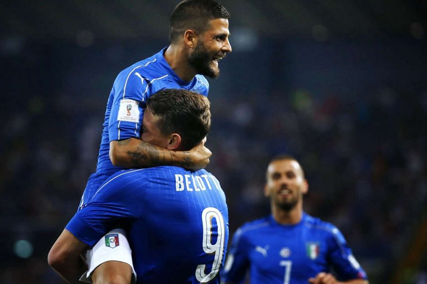 Italy's forward Andrea Belotti (right) celebrates with Italy's forward Lorenzo Insigne (left) after scoring a goal during the FIFA World Cup 2018 qualification football match between Italy and Liechtenstein at the Dacia Arena Stadium in Udine, on Jun