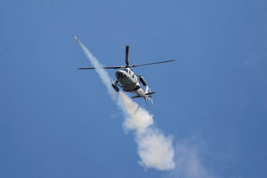 A Philippine Air Force attack helicopter firing a rocket as they continue to assault the Maute group in Marawi City, on May 29, 2017.