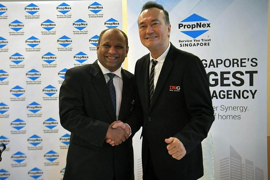 CEO of PropNex Realty,  Mr Ismail Gafoor (left), shaking hands with founder and Chairman of DWG, Dr Dennis Wee.