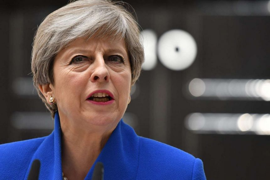 Britain's Prime Minister Theresa May makes a statement outside 10 Downing Street in central London.