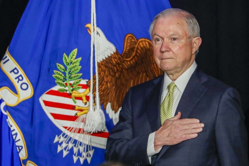 US Attorney General Jeff Sessions participates in the US national anthem at a meeting on June 6, 2017.