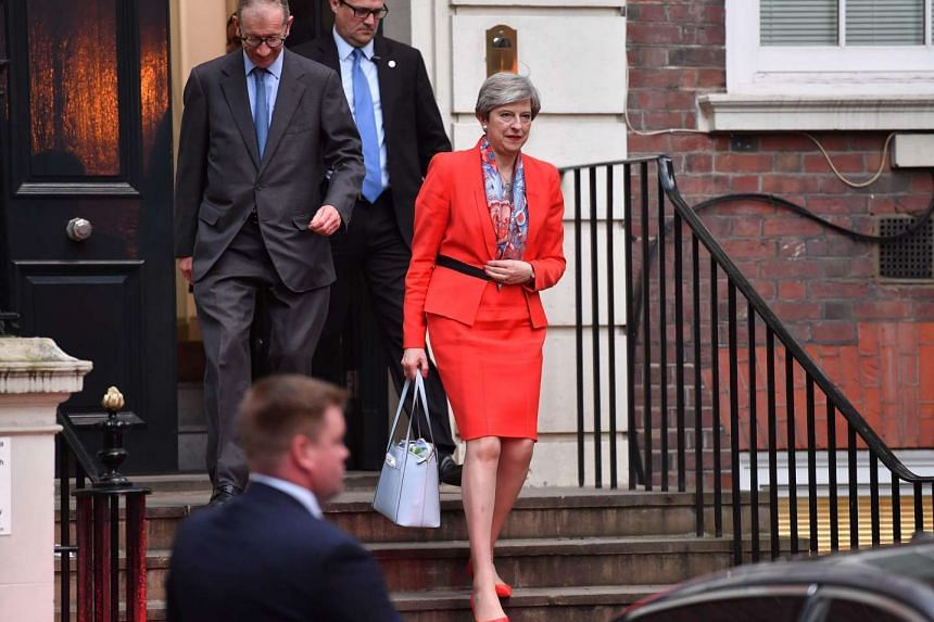 British Prime Minister Theresa May and her husband Philip (left) leave Conservative Party HQ in London.