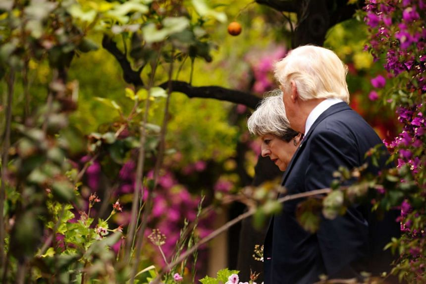 USPresident Donald Trump (R) talks to Britain's Prime Minister Theresa May at the G7 Summit in Italy on May 26, 2017.