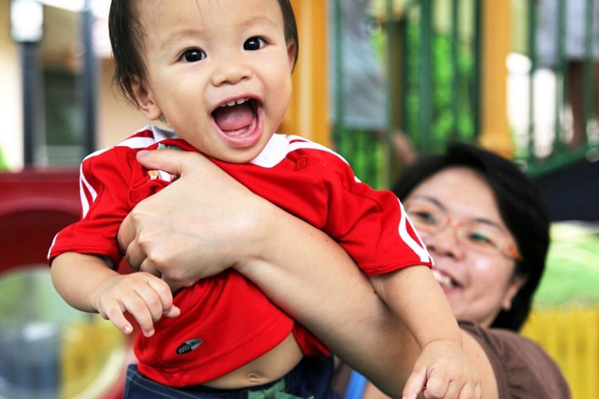 A one-year-old boy showing his teeth.