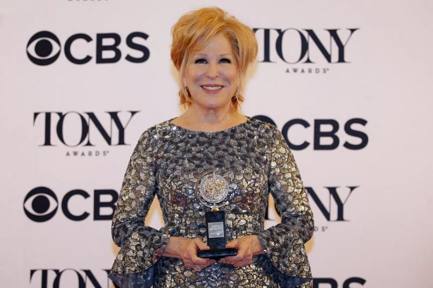 """Bette Midler with her award for Best Performance by an Actress in a Leading Role in a Musical for """"Hello, Dolly!"""" on June 11, 2017."""