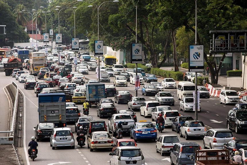 Vehicles sit in traffic on the Jalan Tun Razak road during the rush hour in Kuala Lumpur, Malaysia.