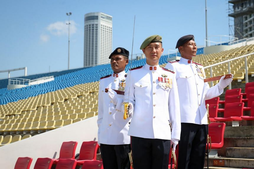 (From left) Second Warrant Officer (2WO) Boharei, Parade Colour Sergeant Major, Lieutenant Colonel (LTC) (NS) Lim Wee Tee, Parade Commander and Master Warrant Officer (MWO) Lim Wee Ming Edwin, Parade Regimental Sergeant Major.