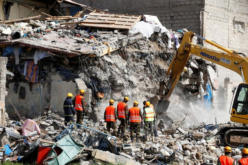 Emergency personnel working at the scene after a building collapsed in a residential area of Nairobi, Kenya, on June 13, 2017.