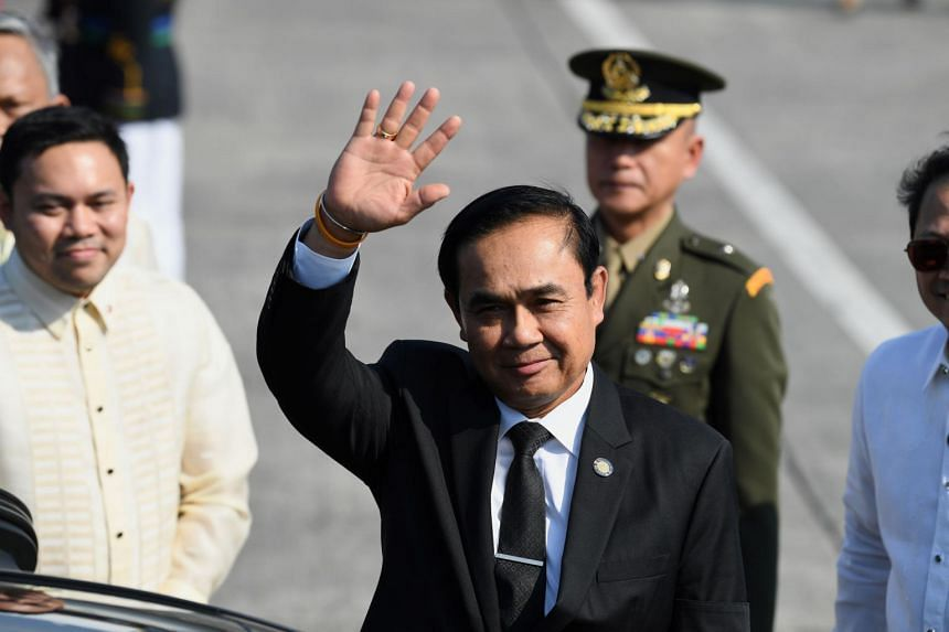 Thailand's Prime Minister Prayut Chan-O-Cha waves upon his arrival at Manila's international airport on April 28, 2017 to attend the Association of Southeast Asian Nations (ASEAN) summit.