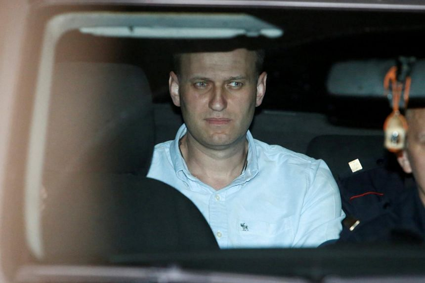 Russian opposition leader Alexei Navalny sits in a police car after being found guilty by a court of repeatedly violating the law on organizing public meetings, in Moscow, Russia on June 13, 2017.