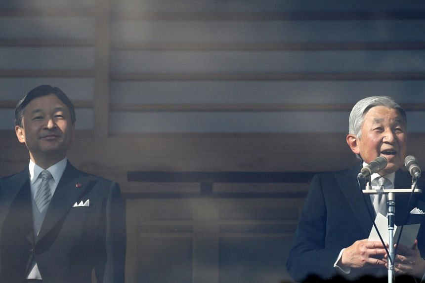 Japanese Emperor Akihito (right) makes a speech as Crown Prince Naruhito stands next to him during a public appearance for New Year celebrations at the Imperial Palace in Tokyo, Japan on Jan 2, 2017.