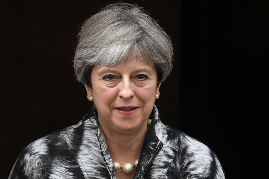 British Prime Minister Theresa May leaves Downing Street on the way to a meeting of the Conservative Party's 1922 Committee, in Central London, Britain on June 12, 2017.