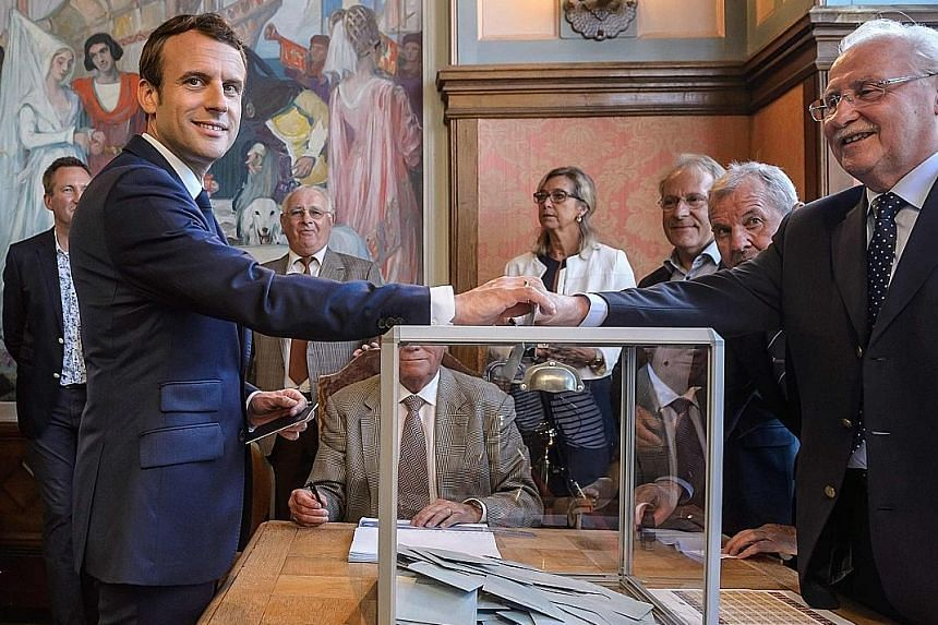 President Emmanuel Macron casting his ballot in Le Touquet on Sunday.
