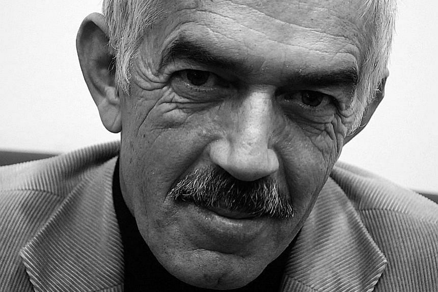 Turkish author Hasan Ali Toptas (above) says the seed of his novel Shadowless was planted by a conversation about whether a snake could swallow his own tail.