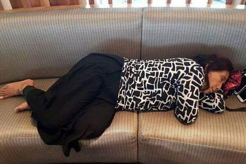 """Indonesia's Maritime and Fisheries Minister Susi Pudjiastuti sleeping on a couch in a VIP lounge of John F. Kennedy Airport in New York. The picture went viral on social media yesterday and won her praise for being a """"super woman""""."""
