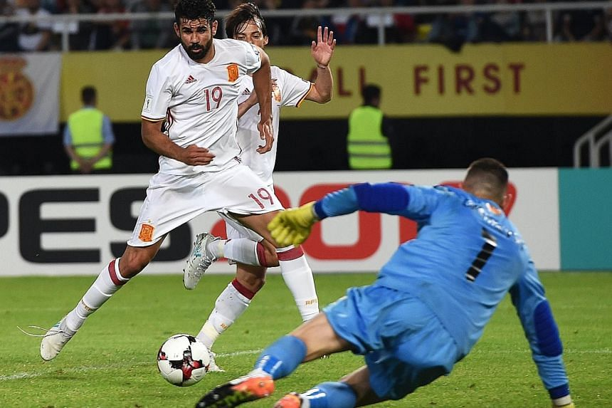 Spain striker Diego Costa (No. 19) scoring the winner in their 2-1 away win over Macedonia to stay top of Group G. With a goal difference of four separating Spain and Italy, their crunch Sept 2 clash at the Santiago Bernabeu promises to be a cagey af