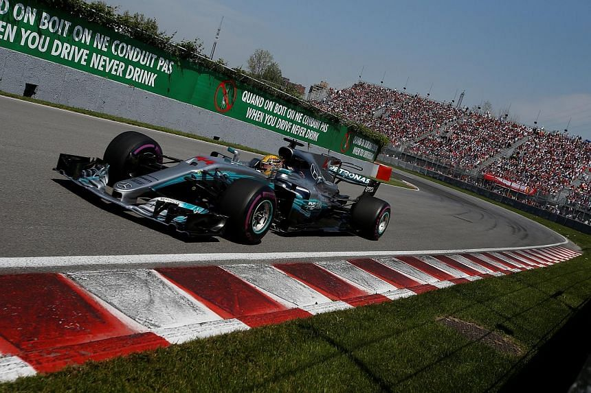 Lewis Hamilton leading the Canadian Grand Prix on Sunday, en route to his sixth victory in 10 years at Montreal. His victory at the Circuit Gilles Villeneuve cut Sebastian Vettel's world championship lead from 25 points to 12.