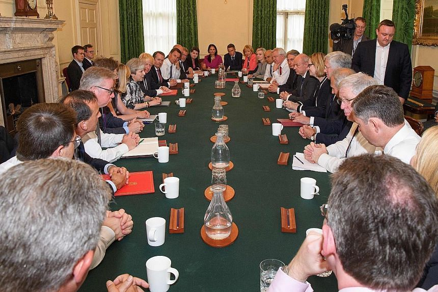 Mrs May has given former adversary Michael Gove a role in her Cabinet, after firing him last year. After last Thursday's election result, she was unable to carry out wholesale Cabinet changes mooted before the election. British PM Theresa May (centre