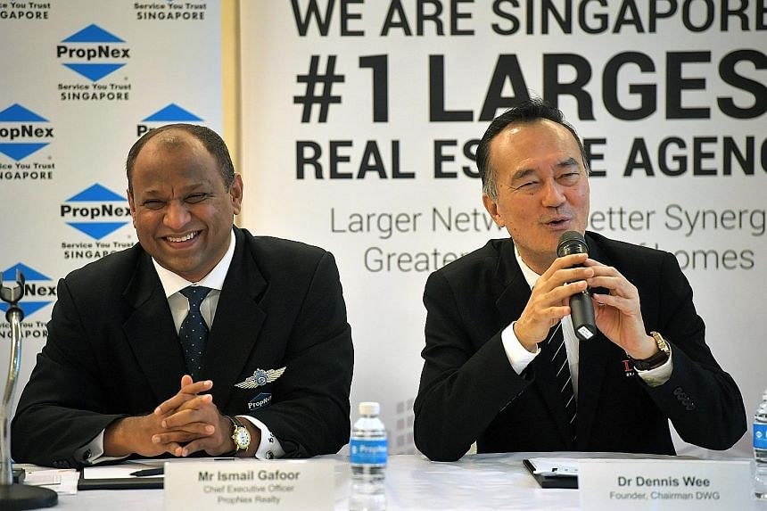"""PropNex Realty chief executive Ismail Gafoor and Dennis Wee Group founder and chairman Dennis Wee at the press conference yesterday. Mr Wee said the group has been fielding acquisition offers for three years, but Mr Ismail struck him as the """"most sin"""