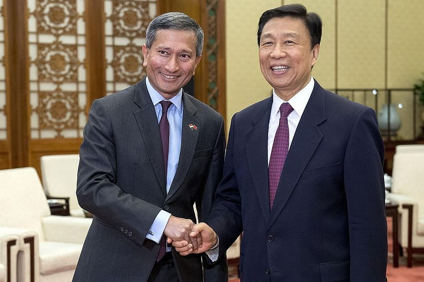 Foreign Minister Vivian Balakrishnan with his Chinese counterpart Wang Yi in Beijing yesterday. China welcomes Singapore's participation in the Belt and Road Initiative, said Mr Wang. Dr Vivian Balakrishnan calling on Chinese V-P Li Yuanchao in Beiji