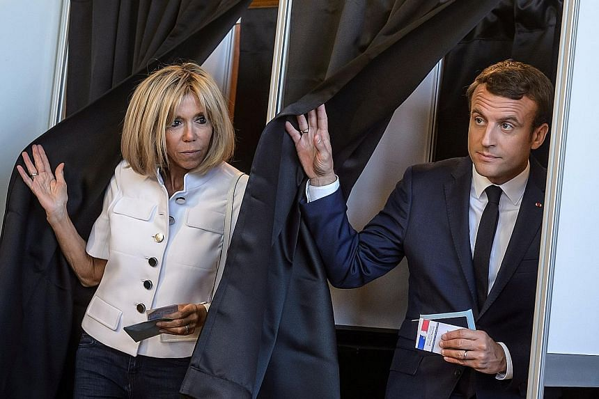 French President Emmanuel Macron and his wife Brigitte casting their ballots in Le Touquet in the first round of parliamentary elections. Supporters of French President Emmanuel Macron's Republique En Marche party cheering in Paris after polls closed
