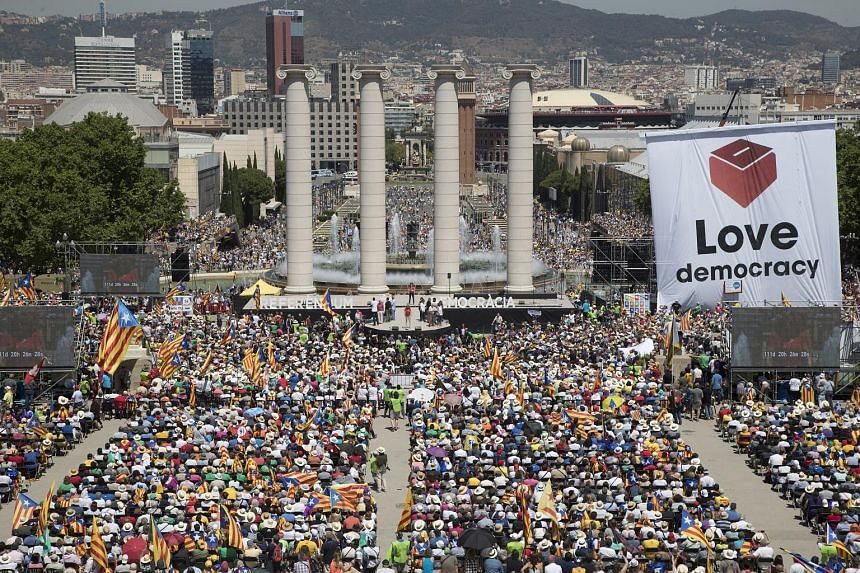 Tens of thousands of demonstrators at a rally in support of the independence referendum in Montjuic, Barcelona, in the Catalonia region of Spain, on Sunday. The issue has put civil servants in Catalonia - who are needed to help organise the vote - in