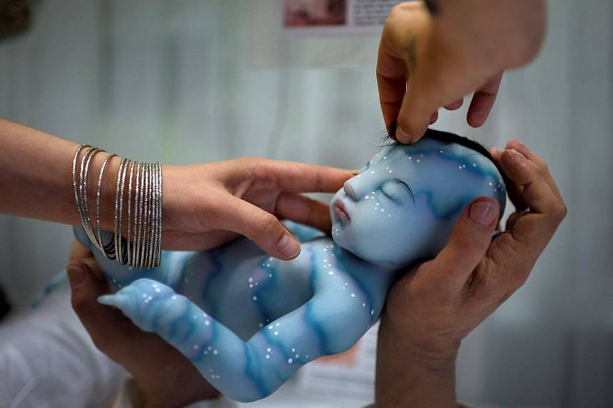 Babyclon owner Cristina Iglesias adjusting an Avatar baby at the Bilbao Reborn Doll Show, in Bilbao, northern Spain, on June 11, 2017.