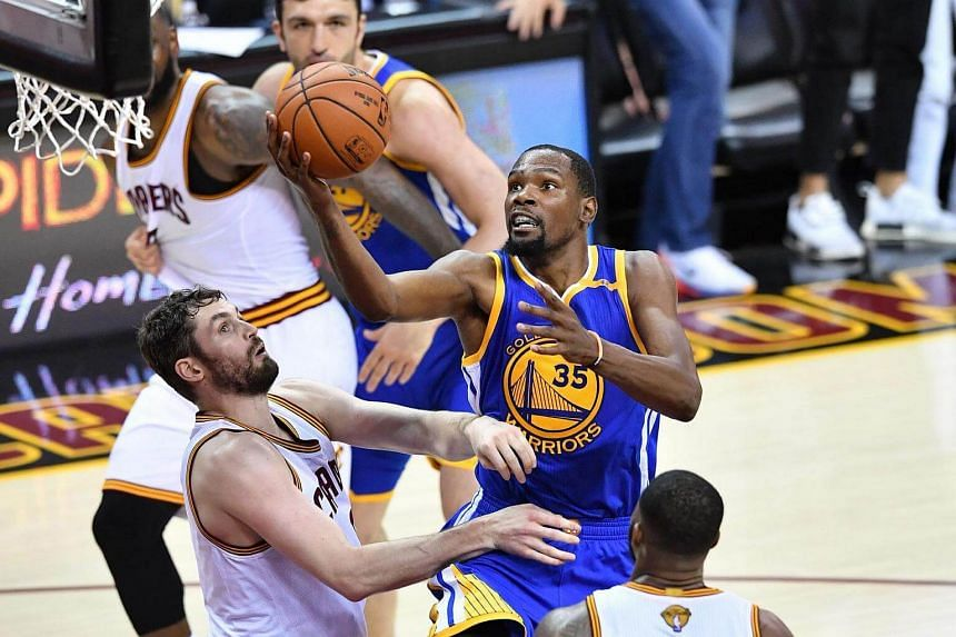 Golden State Warriors' Kevin Durant attempts a shot in Game 4 of the NBA finals on June 9, 2017.