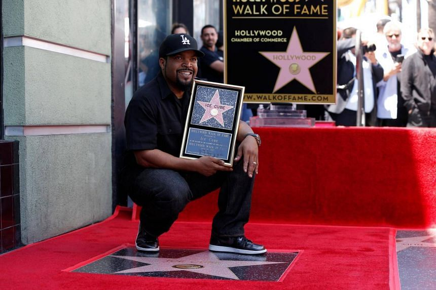 Rapper Ice Cube poses by his star after it was unveiled on the Hollywood Walk of Fame in Los Angeles, California, US, on June 12, 2017.