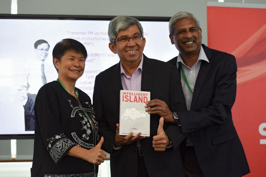 Co-curators of the book Grace Chng (left) and P. Ramakrishna (right)  with Dr Yaacob Ibrahim, Minister for Communications and Information at the book launch.