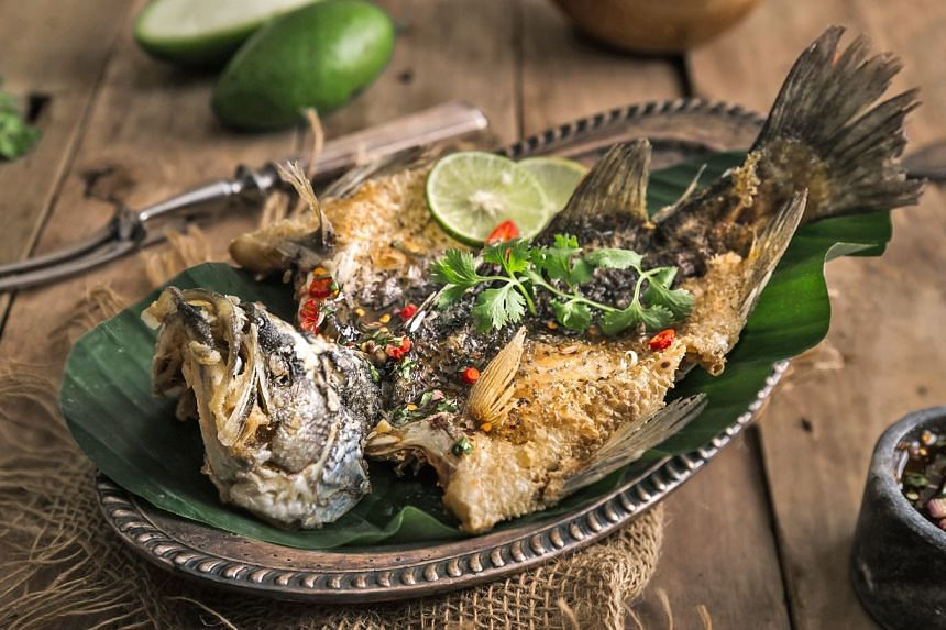 The dancing crispy sea bass is garnished with green mango salad instead of a chilli-based sauce.