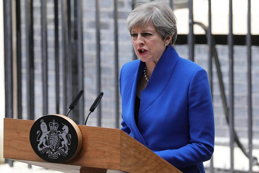 British PM Theresa May delivers a statement to the media outside 10 Downing Street on June 9, 2017.