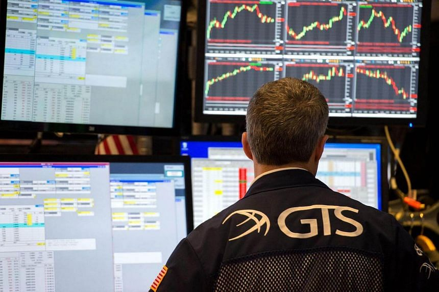 A trader works on the floor of the New York Stock Exchange at the closing bell of the Dow Jones Industrial Average on June 8, 2017.