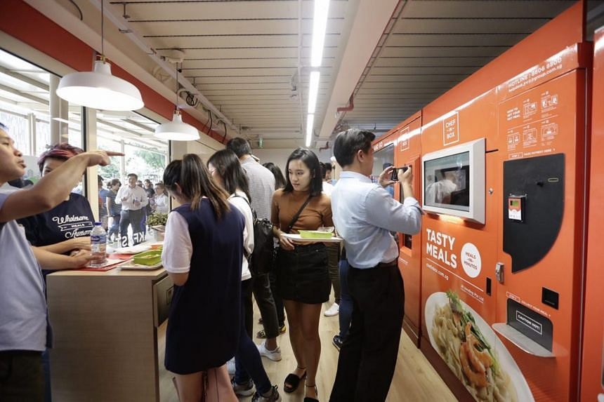 Customers may opt to eat the food at standing dining tables next to the vending machine.