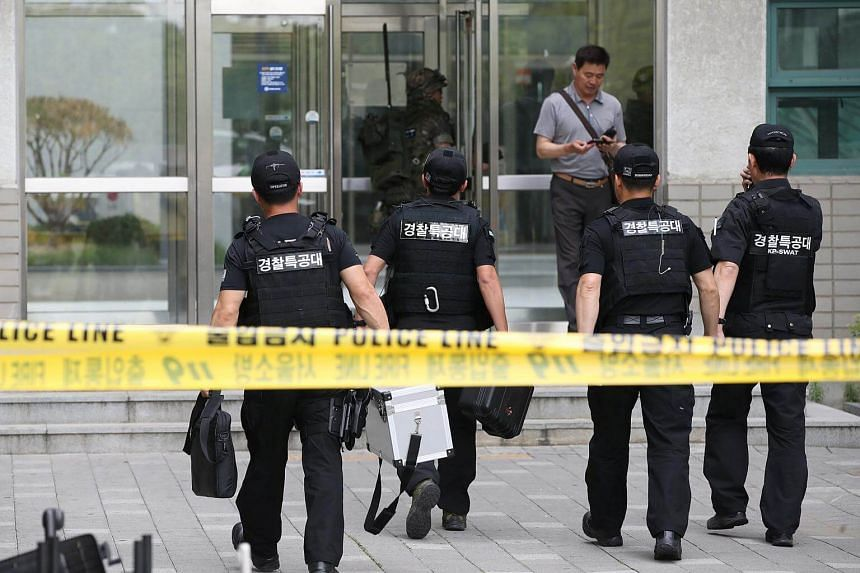Members of Special Weapons and Tactics team arrive at the scene of an accident at Yonsei University in Seoul, on June 13, 2017.