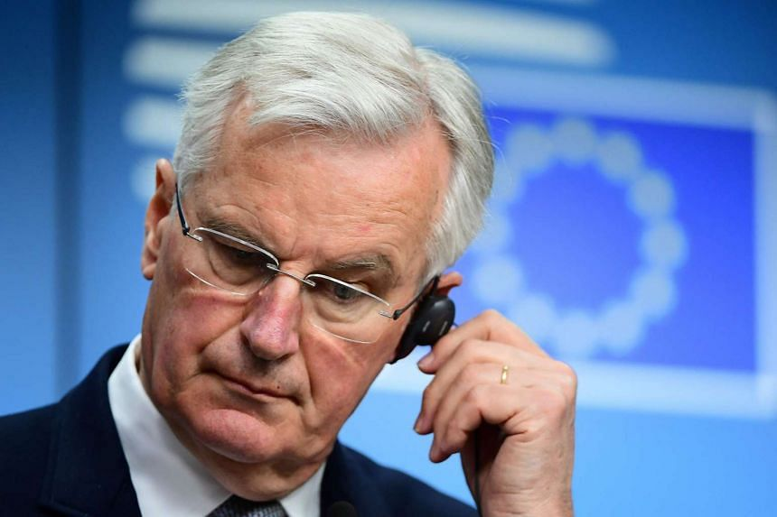 European Commission member in charge of Brexit negotiations with Britain, Michel Barnier, gestures during a press conference.
