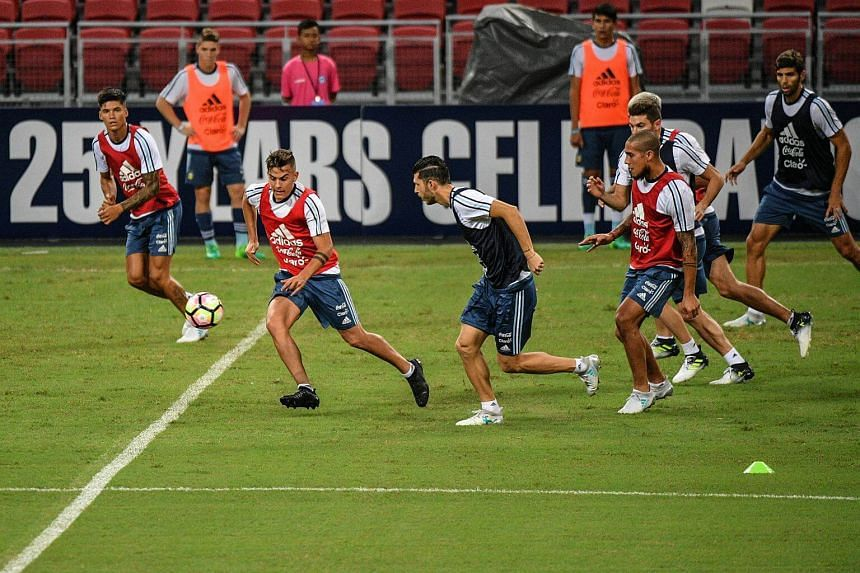 Paolo Dybala (left) of Juventus in action during the official training session for the Argentina Football Team at the Singapore Sports Hub on June 12, 2017.
