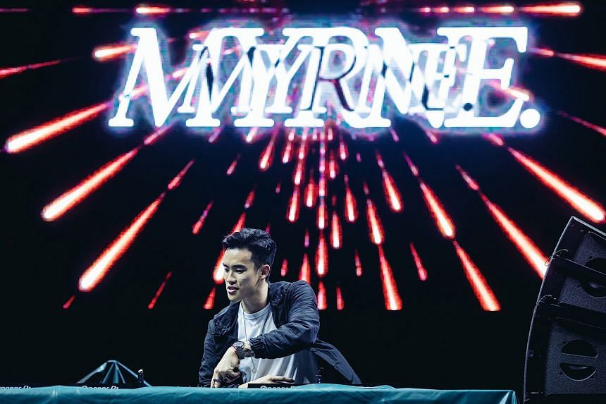 Singaporean DJ-producer Myrne (above) playing through a rain-soaked set last Saturday. Others that performed at the Live Stage were Rob Swire, lead singer of Pendulum, and American DJ-Producer KSHMR and dancers.