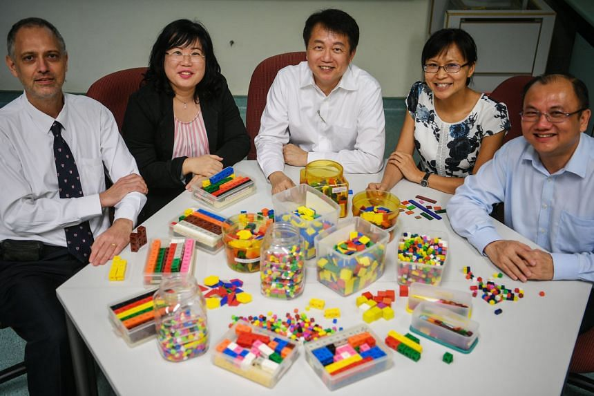 (From left) Dr Paul Shutler, Dr Dawn Ng, Associate Professor Lee Ngan Hoe, Dr Cheng Lu Pien and Dr Joseph Yeo from NIE, with learning tools used for teaching the Singapore maths model method. They are designing teaching materials for Australia, which will