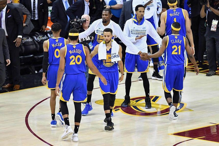 Stephen Curry #30 of the Golden State Warriors reacts with teammates after being defeated by the Cleveland Cavaliers in Game 4 of the 2017 NBA Finals, on June 9, 2017.