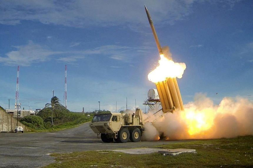A Terminal High Altitude Area Defense (THAAD) interceptor is launched during a successful intercept test, in this undated handout photo provided by the US Department of Defence, Missile Defence Agency.