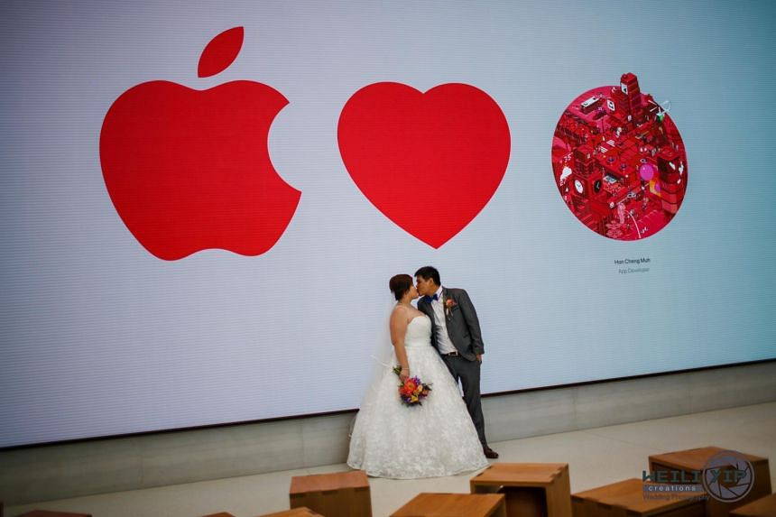 Mr Jermyn Wee and Ms Chia Suat Huang decided to have their wedding photoshoot at the Apple store in Orchard Road the moment they heard it was open.
