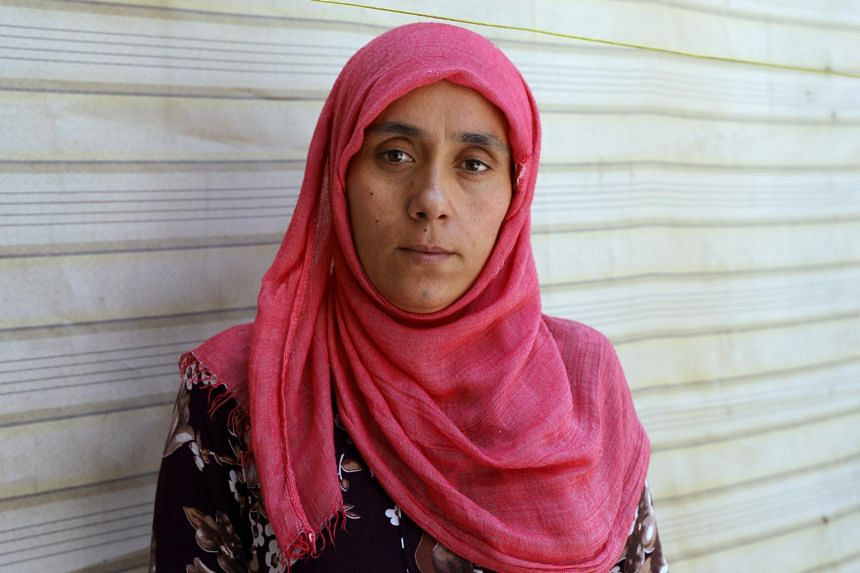 Noura Khodr Khalaf, 24, a Yazidi woman who was recently freed from Islamic State, poses in a centre belonging to the Kurdish-led administration in Qamishli, Syria on June 10, 2017.