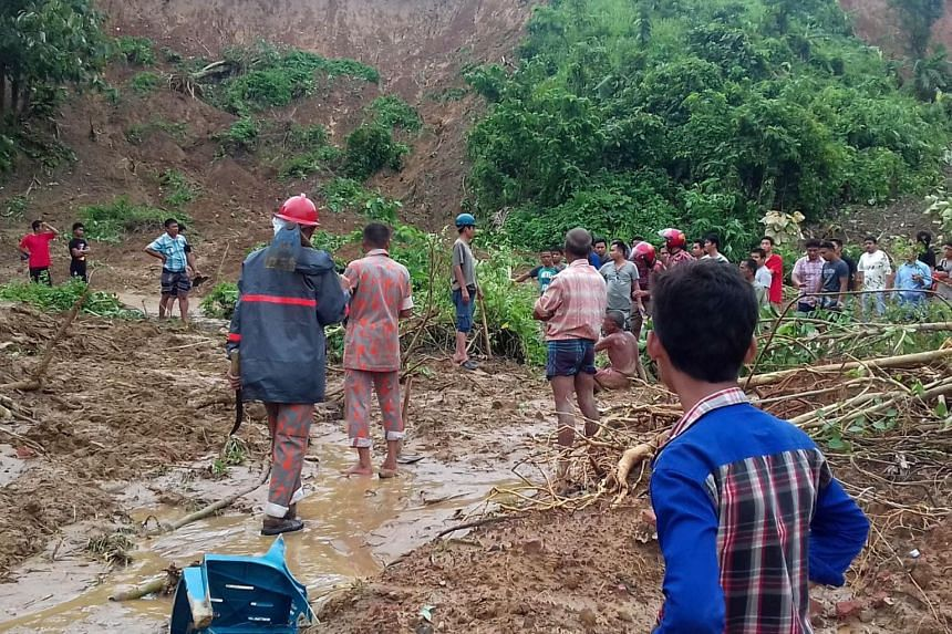 Bangladeshi firefighters search for bodies after a landslide in Rangamati on June 13, 2017.
