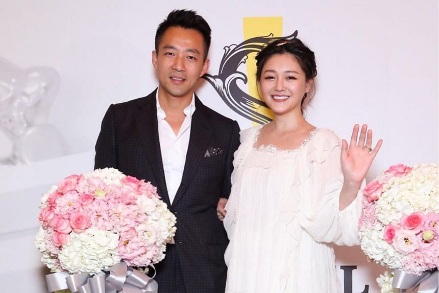 Actress Barbie Hsu and her husband, businessman Wang Xiaofei, at the opening of S Hotel in Taipei on June 13, 2017.