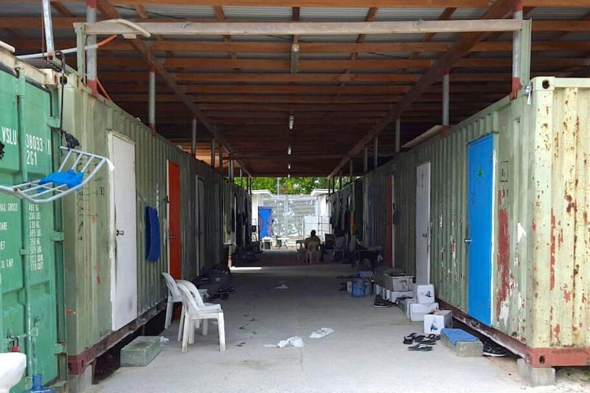 Chairs can be seen outside containers used as shelters inside the Manus Island detention centre in Papua New Guinea, on Feb 11, 2017.