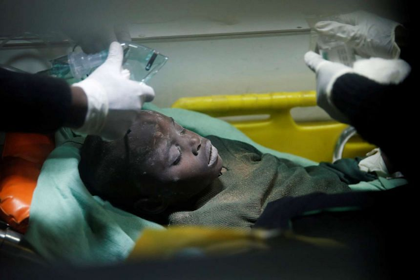 A child rescued from the rubble of a building that collapsed in Kenya receives medical attention.
