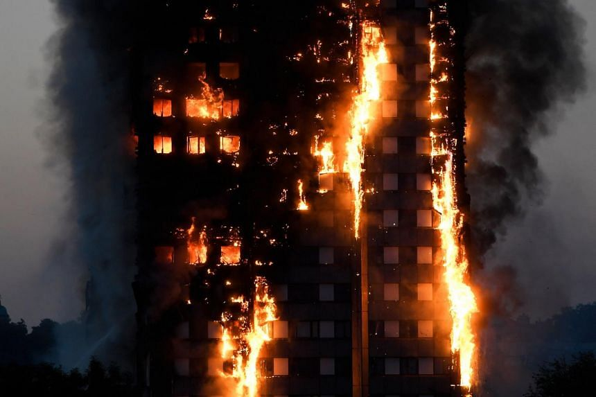 Flames and smoke billow as firefighters deal with a serious fire in a tower block at Latimer Road in West London, Britain, on June 14, 2017.
