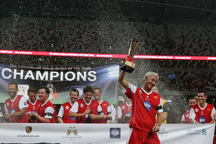 Ian Rush raises the trophy as his Liverpool Masters teammates celebrate after the Castlewood Battle of the Reds between the legends of Manchester United and Liverpool held at National Stadium on Nov 14, 2015.