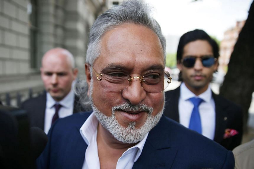 Vijay Mallya being mobbed by members of the press as he leaves court in central London on June 13, 2017.
